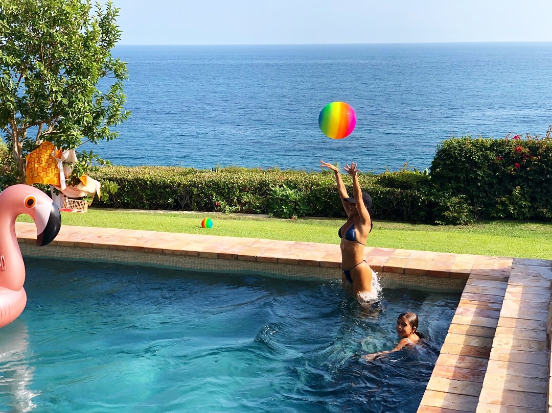 Kourtney Playing with Kids in Pool Rainbow Ball