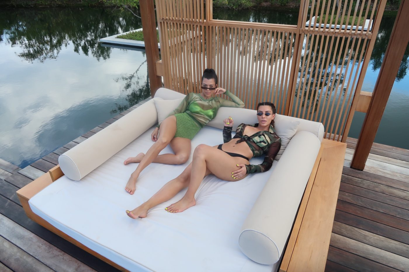 Kourtney and Kim Green Swimsuits by the Pool