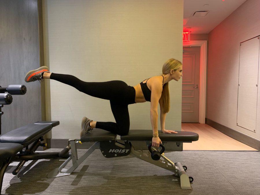 woman doing Kettlebell Balancing Single Arm Rows