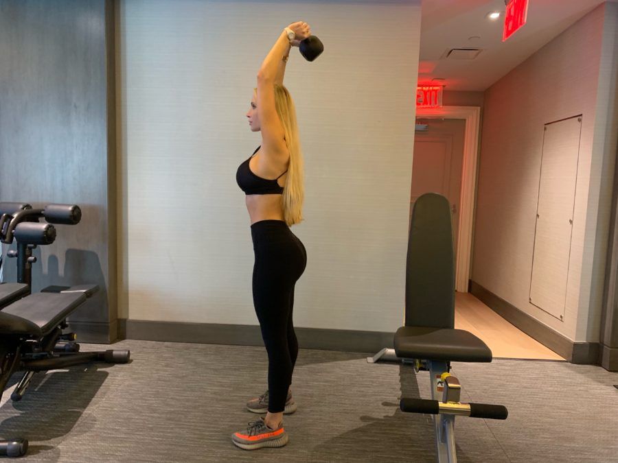woman doing Kettlebell Tricep Extension