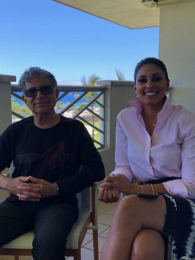 Deepak Chopra and Rachel Roy sitting on patio