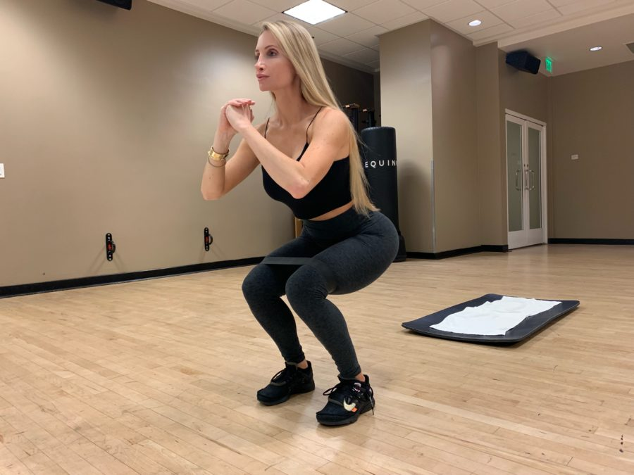 Amanda Lee doing Banded Squat Hold with Abduction