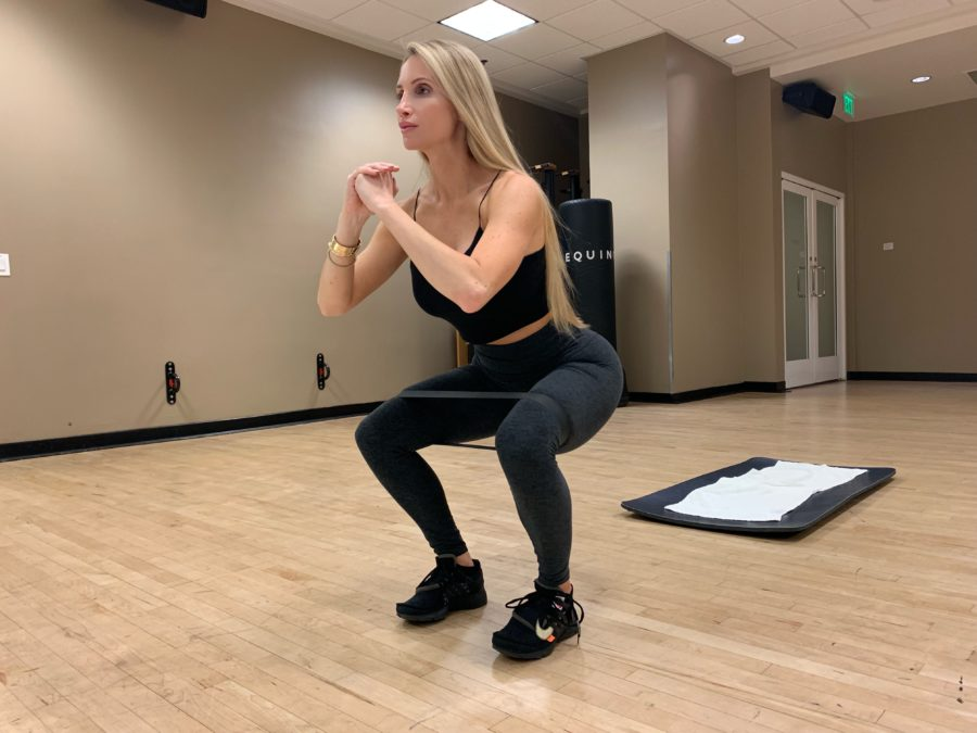 woman doing Banded Squat Hold with Abduction