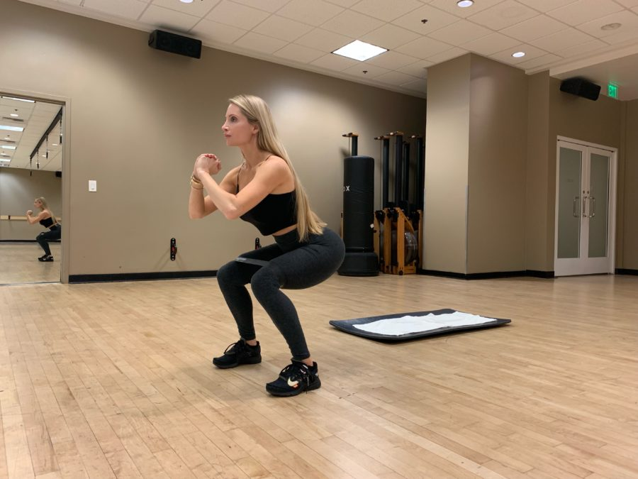 Woman Working Out Banded Side Step Squat Walk