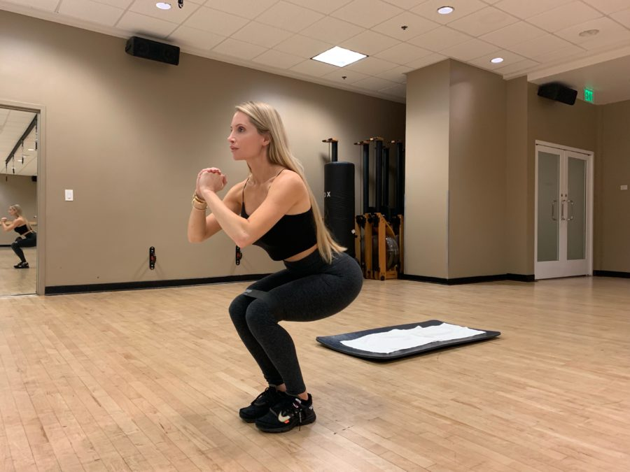 Woman doing Banded Side Step Squat Walk