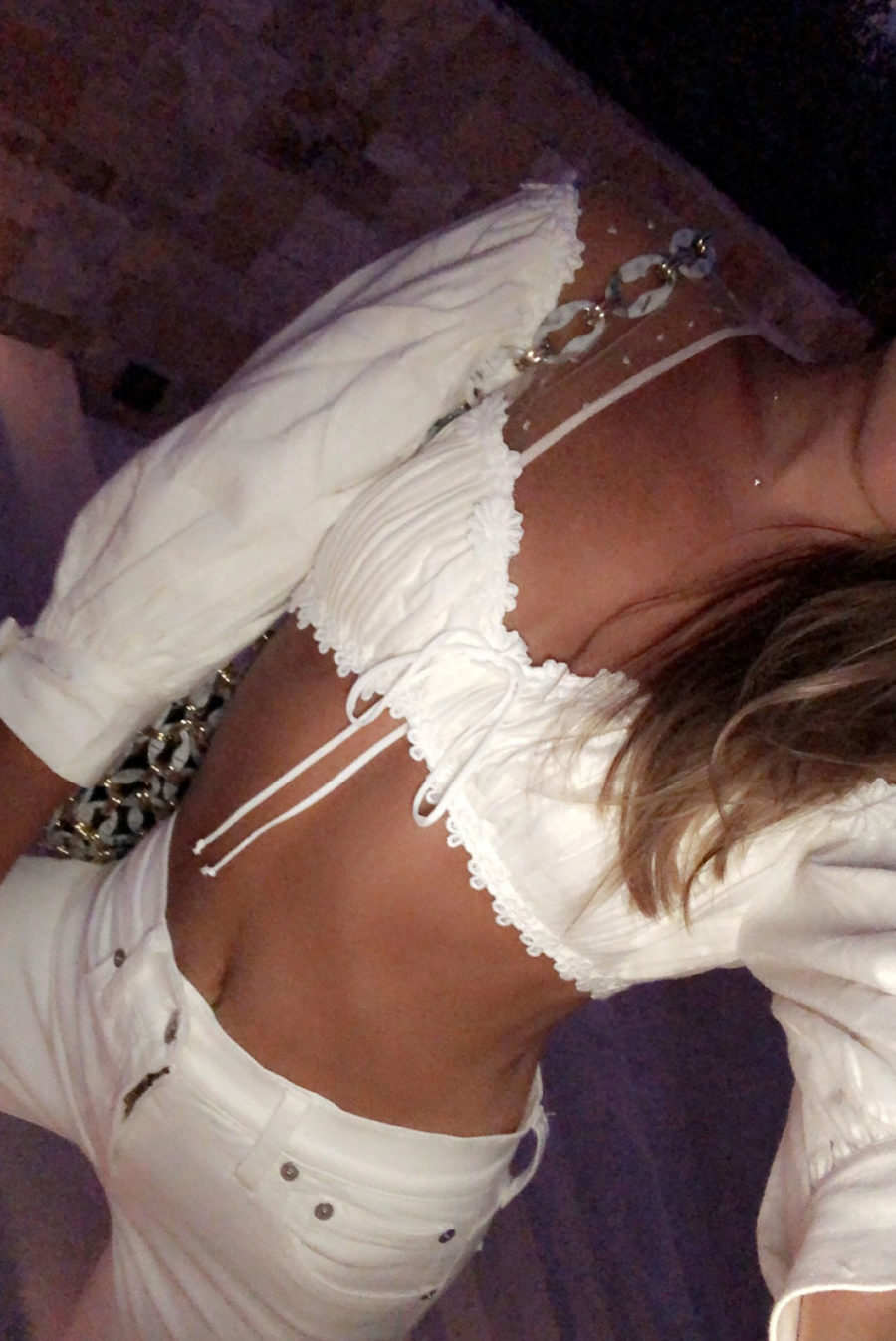 woman wearing white crop top and white jeans