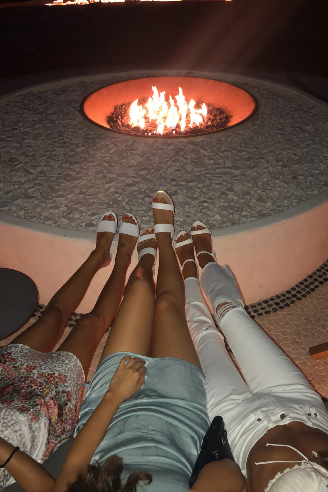 women by fire pit in mexico