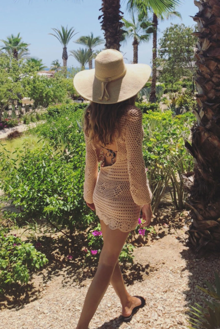 woman wearing oversized sun hat and coverup