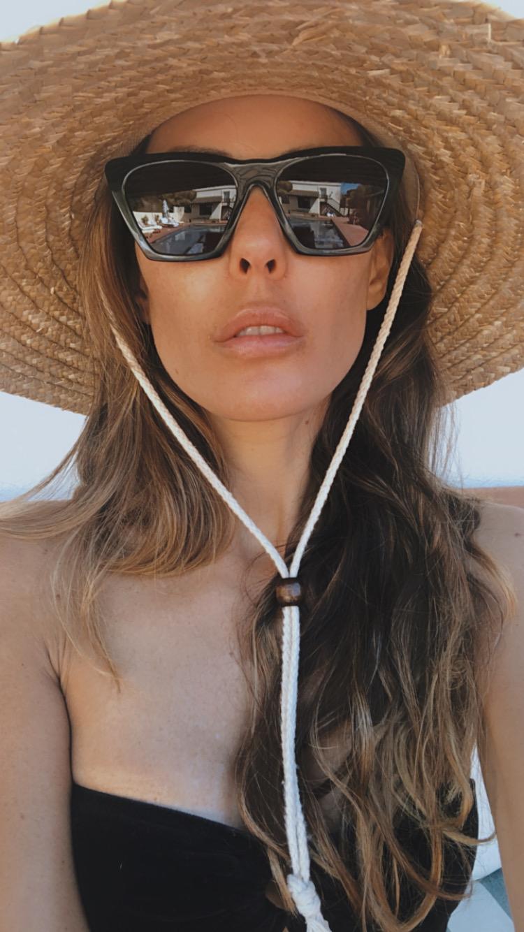 sarah howard wearing sunglasses