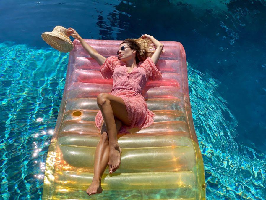 sarah howard in pool wearing dress