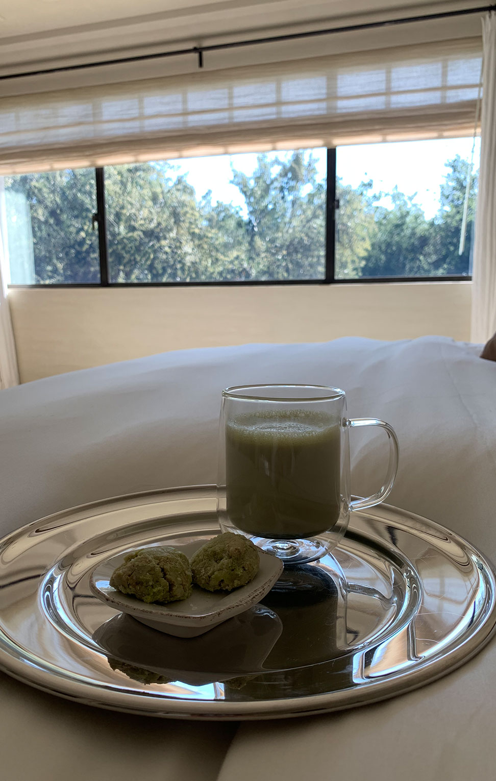matcha latte with cookies in bed