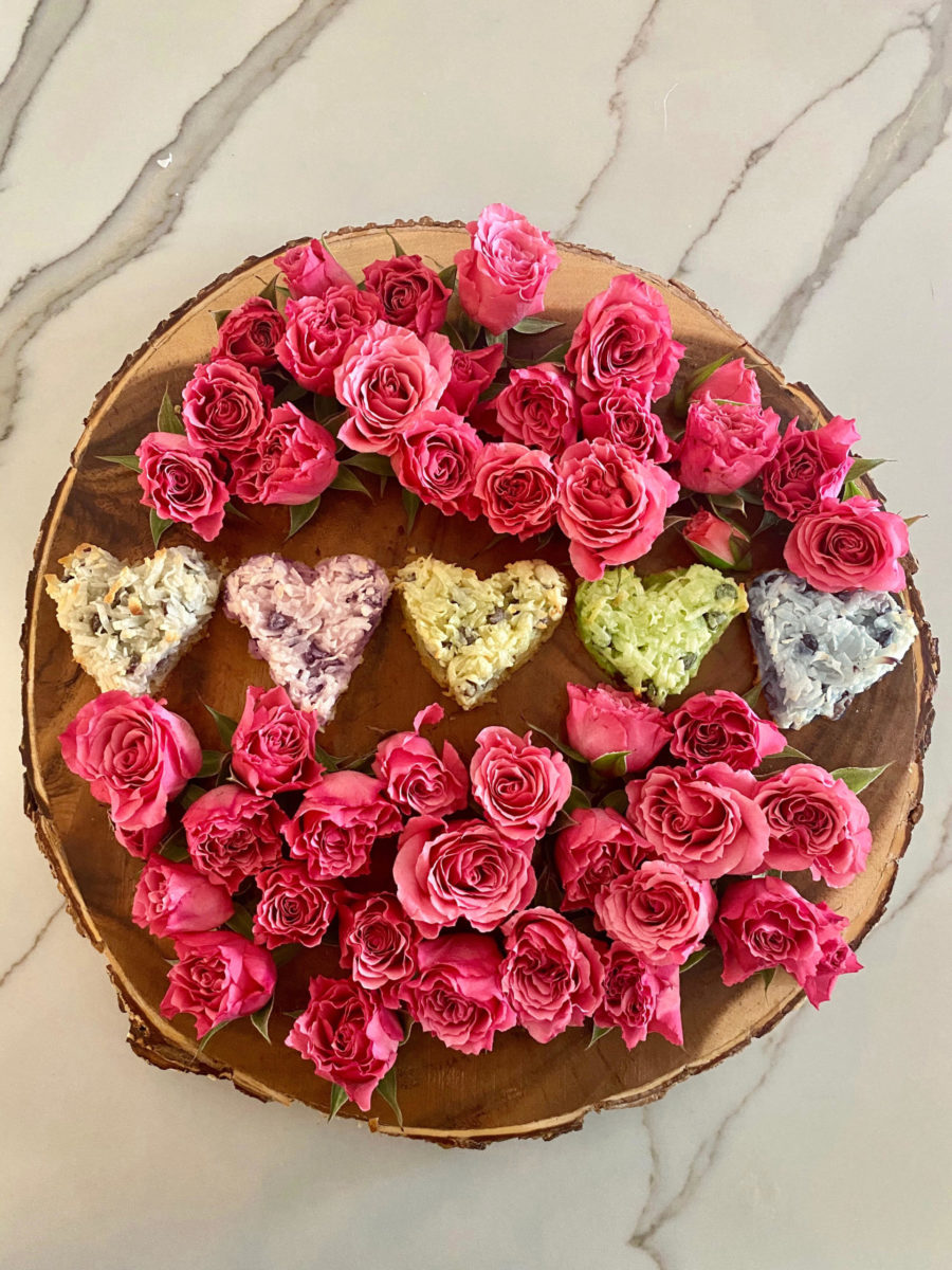 Organic and Gluten-Free Coconut Macaroons on tray with pink roses