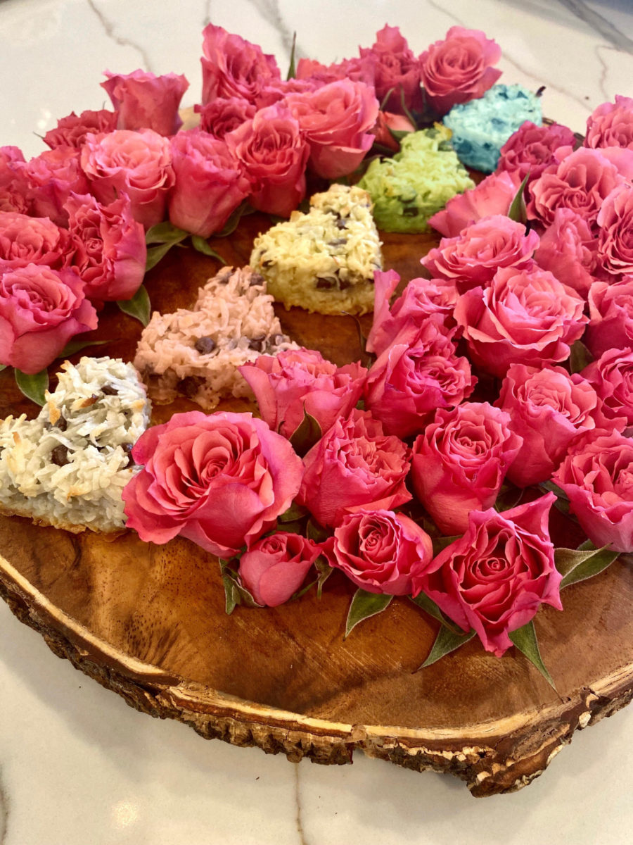 heart-shaped Coconut Macaroons on tray with pink roses