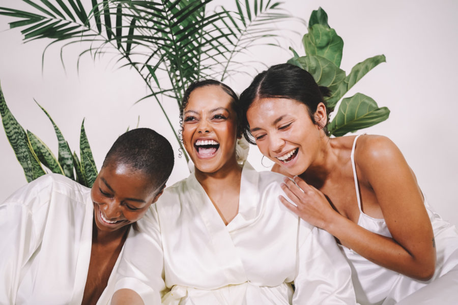 three women laughing in campaign photo for Agrestal Beauty
