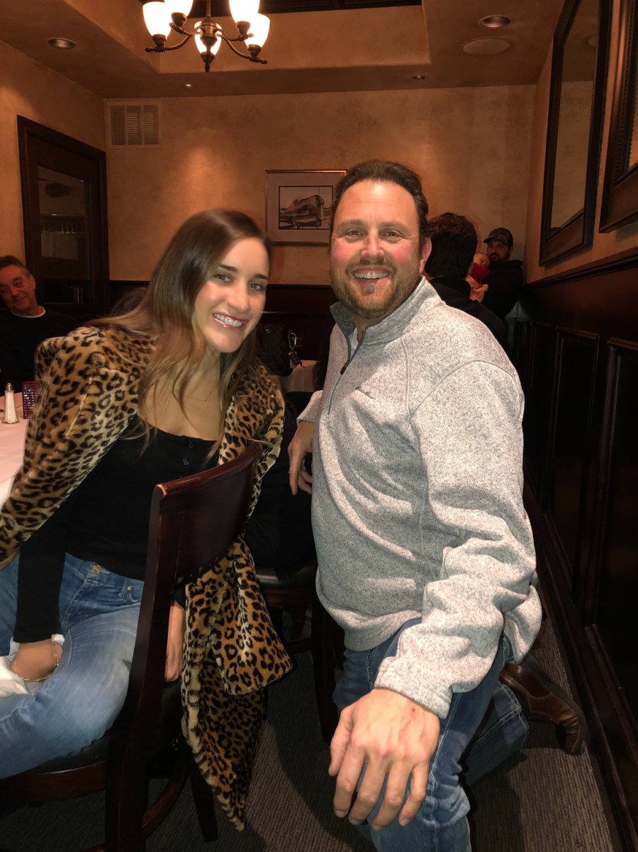 woman in leopard coat posing with man