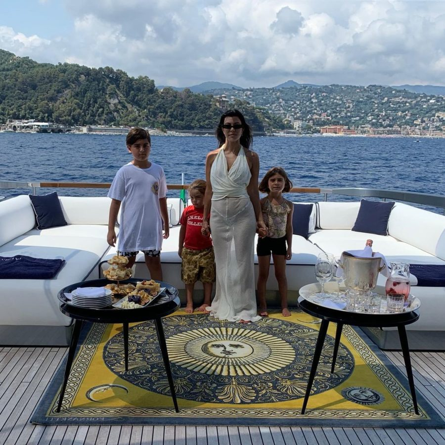 kourtney kardashian and kids on boat in Italy