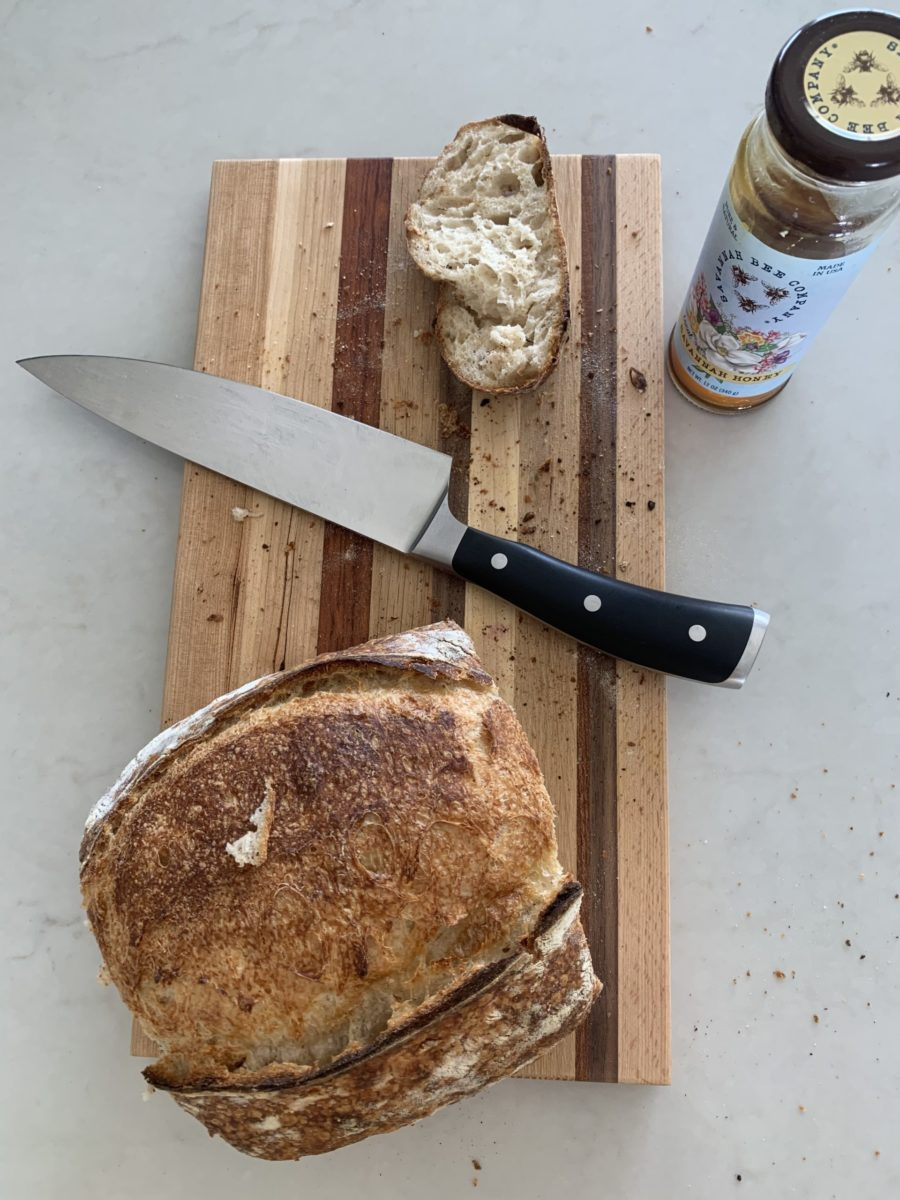 bread honey and butter on cutting board