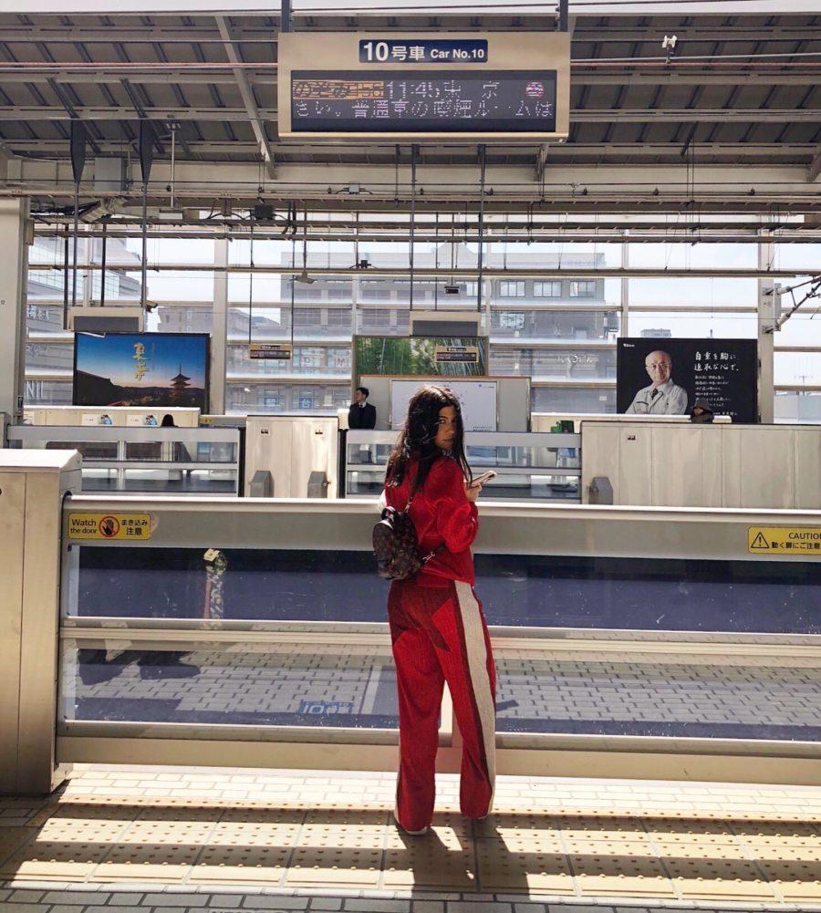 kourtney kardashian in japan wearing red track suit