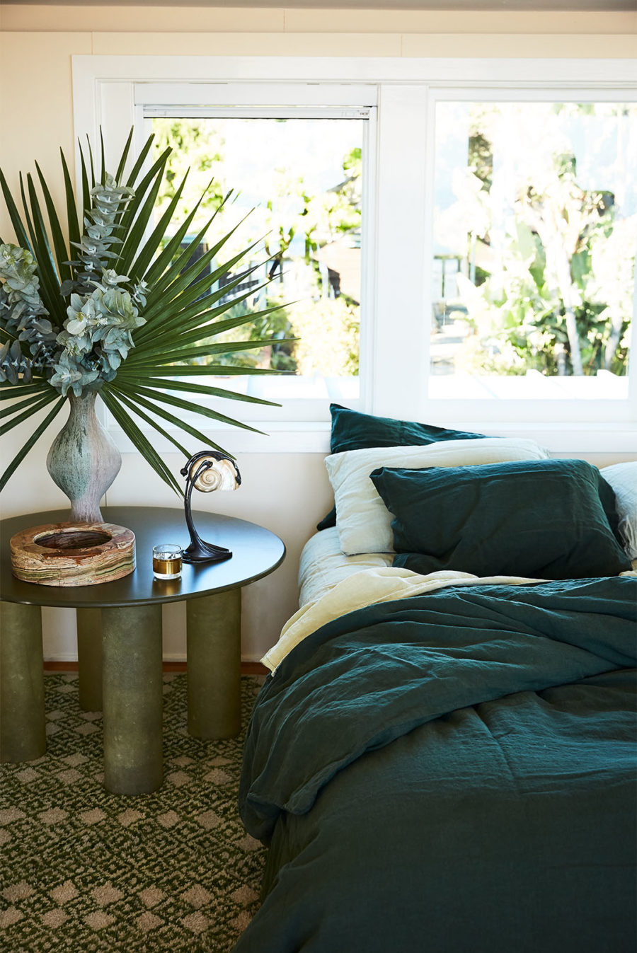 Bedroom photo with plants and bedside table