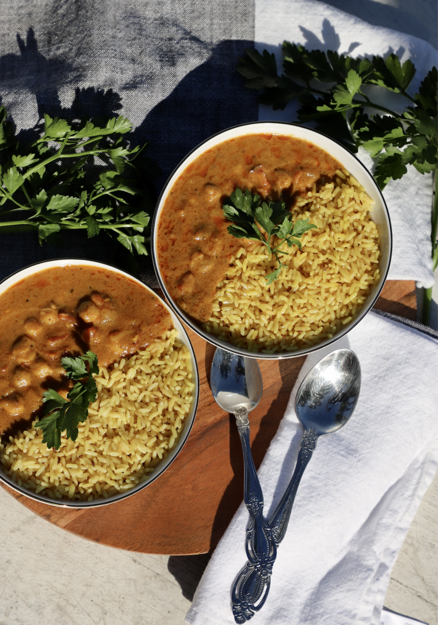 two bowls of Plant-Based Tikka Masala with rice
