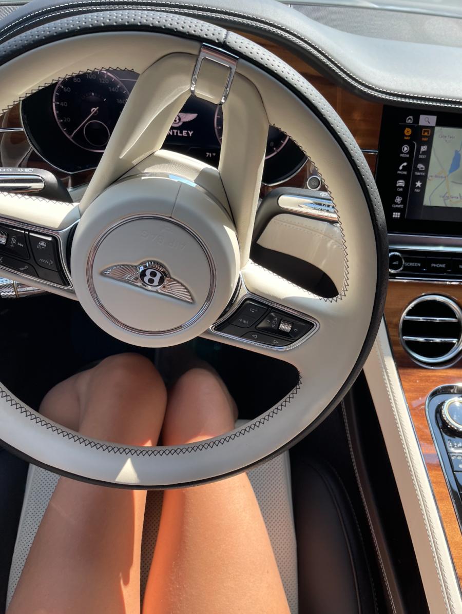 woman driving Bentley
