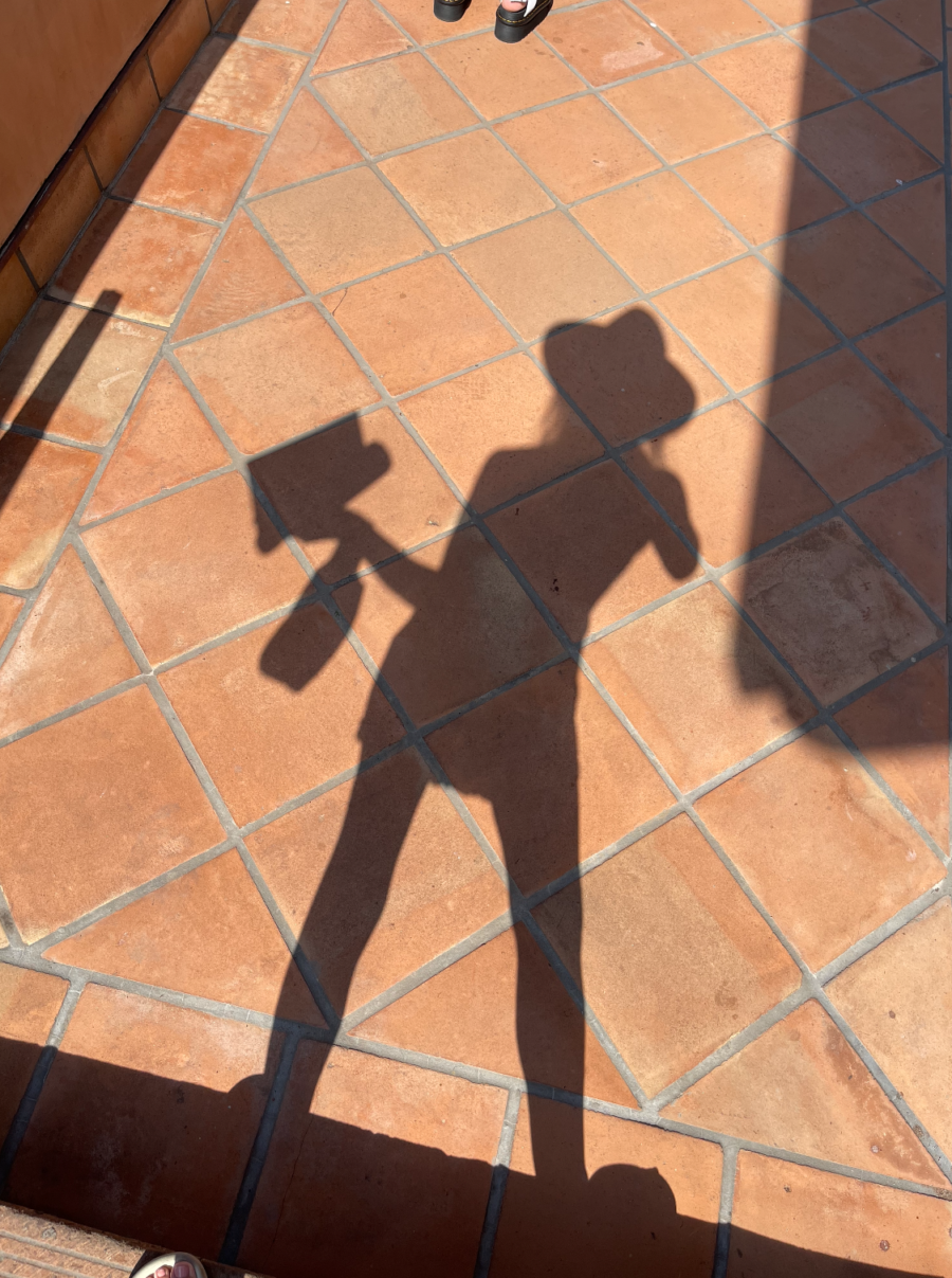 shadow of a woman wearing hat