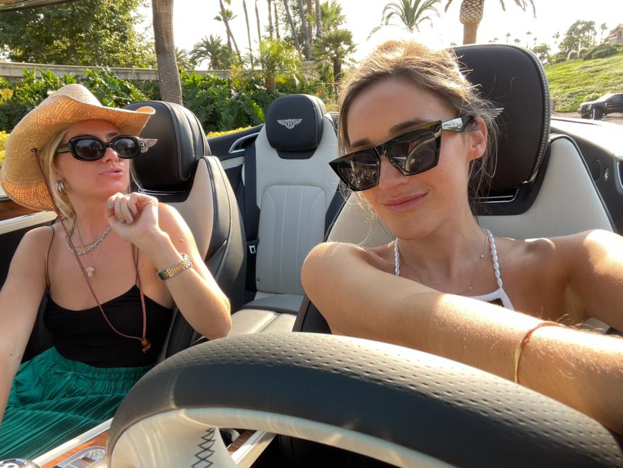 two girls in Bentley convertible