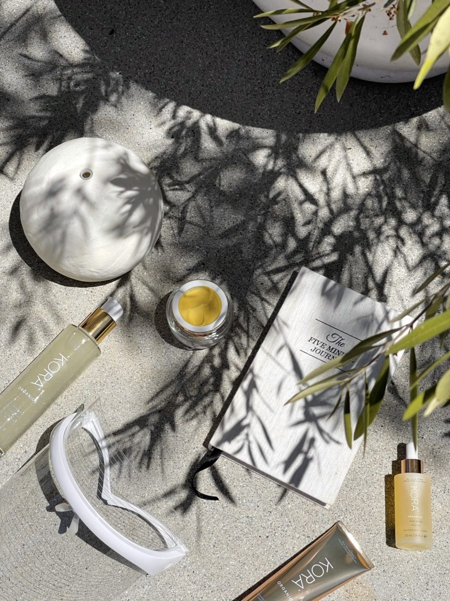 beauty and skincare products flat lay outside