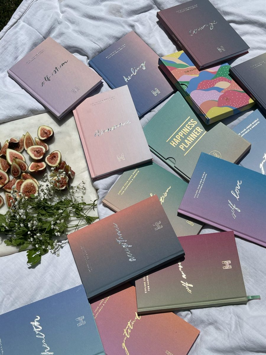 happiness journals on picnic blanket