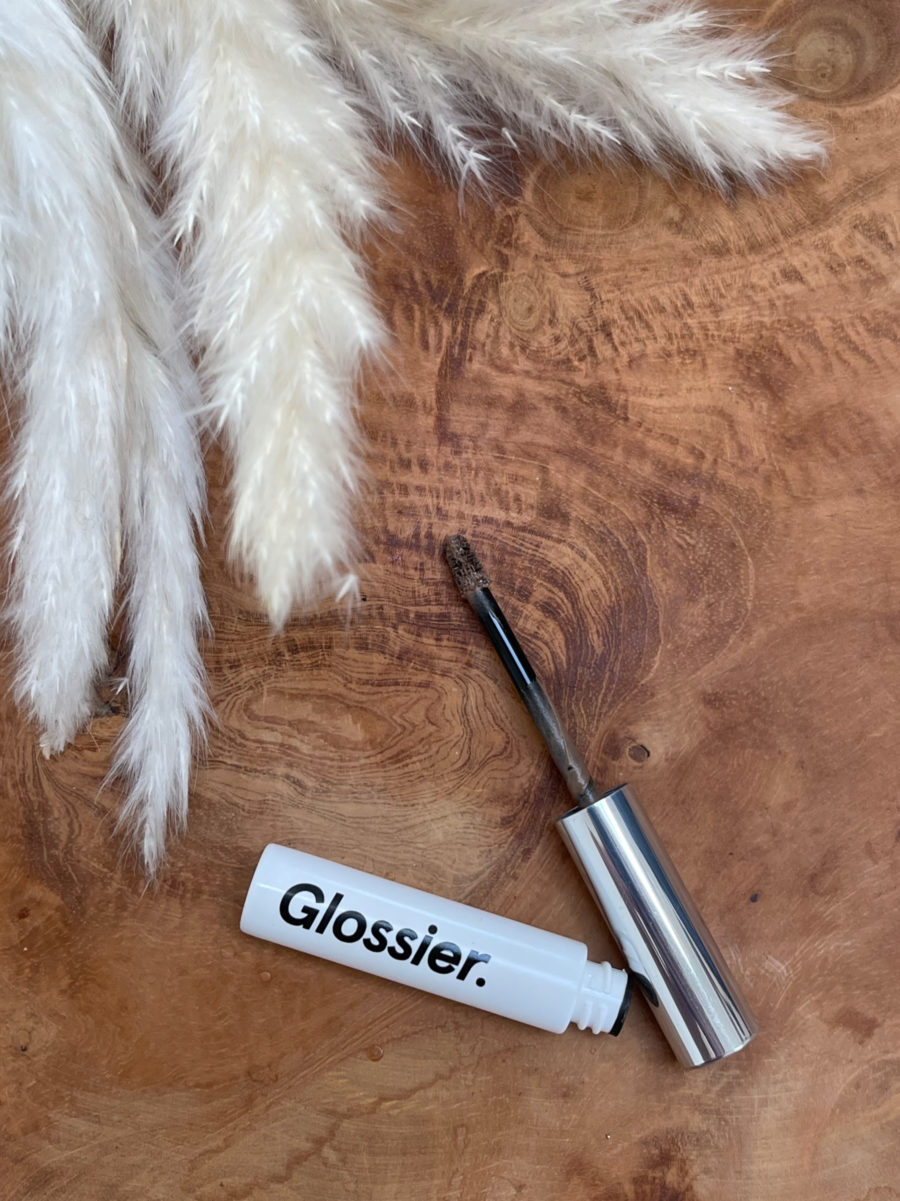 glossier boy brow open by white fluffy pampas grass