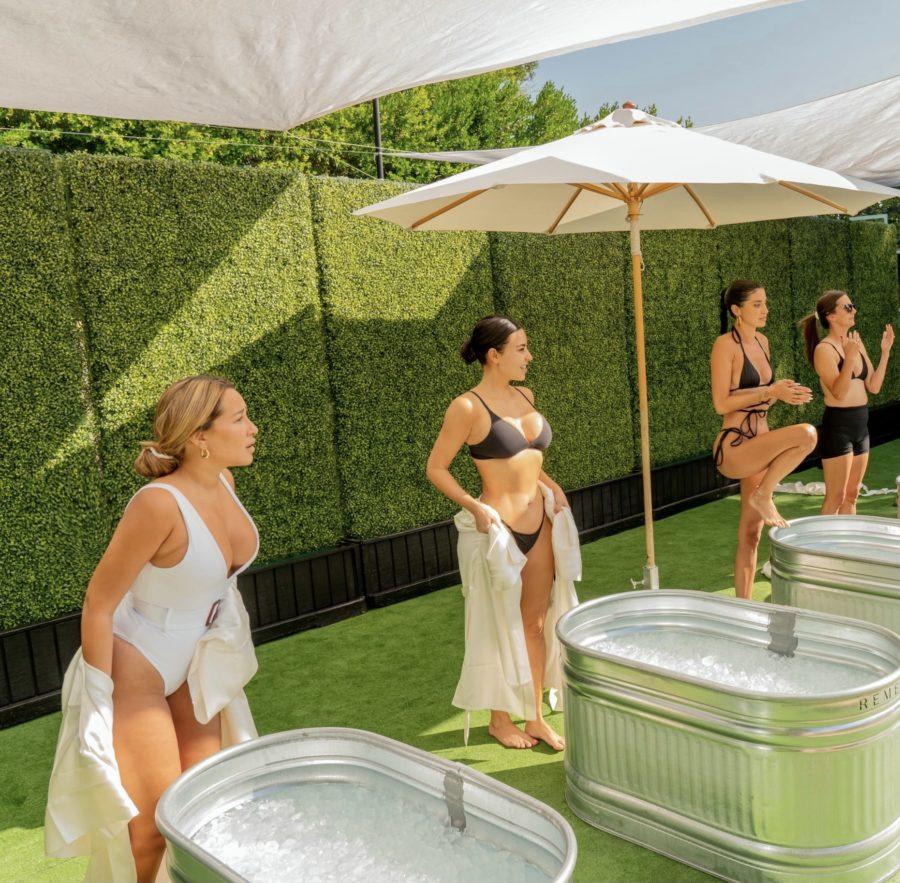 kim kardashian, nicole williams, and adrienne bailon in ice bath poosh poolside event