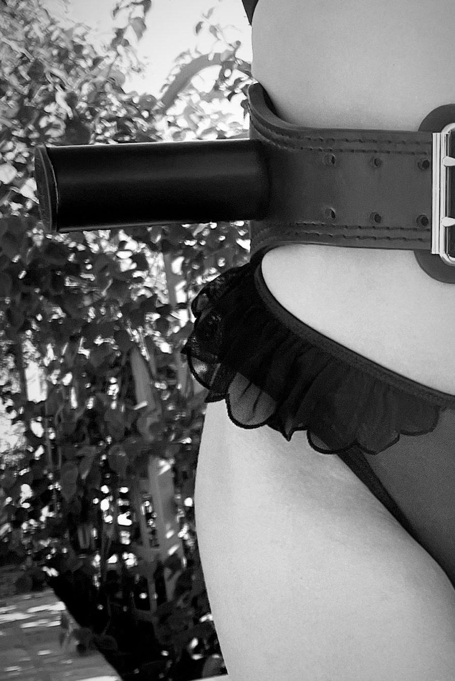 woman wearing MunkeyBarz Sex Belt with ruffle underwear black and white photo